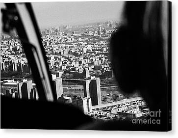 Helicopter Flies Over Harlem And East River New York City Canvas Print by Joe Fox