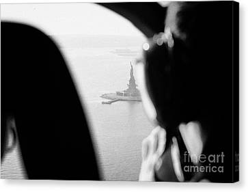 Helicopter  Flies Over Statue Of Liberty As Seen Through The Plexiglas New York Canvas Print by Joe Fox