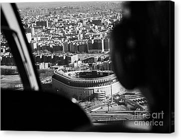 Helicopter  Flies Over Yankee Stadium New York City Canvas Print by Joe Fox