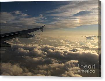 Canvas Print featuring the photograph High Above The Clouds by Inge Riis McDonald