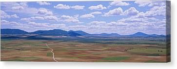 High Angle View Of A Dirt Road Passing Canvas Print