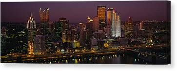 High Angle View Of Buildings Lit Canvas Print by Panoramic Images