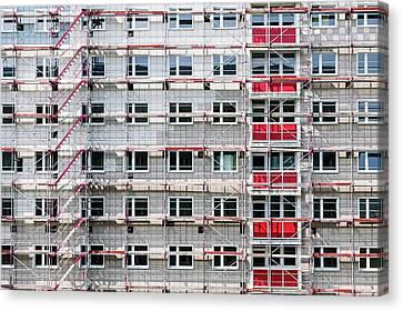 High Building House In Scaffolding Canvas Print by Wladimir Bulgar