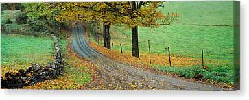 Highway Passing Through A Landscape Canvas Print by Panoramic Images
