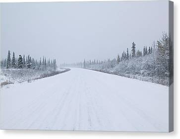 Highway Passing Through A Snow Covered Canvas Print by Panoramic Images