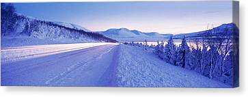 Highway Running Through A Snow Covered Canvas Print by Panoramic Images