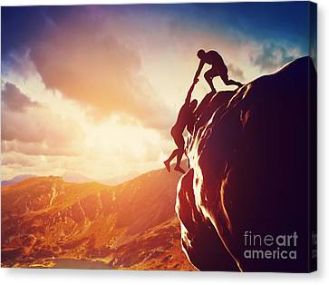 Hiker Giving Hand And Helping In Mountains Canvas Print