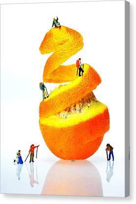Hikers Climbing Orange Mountain Canvas Print by Paul Ge