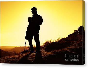 Twilight Views Canvas Print - Hiking Couple by Carlos Caetano