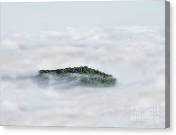 Hill Top Island In The Clouds Canvas Print by Dan Friend