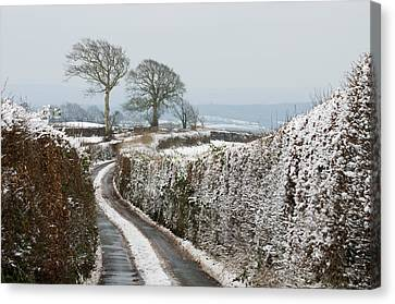 Hill Top Lane In Snow Canvas Print by Pete Hemington