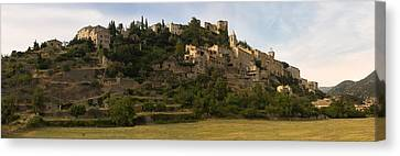 Hilltop Town Of Montbrun-les-bains Canvas Print by Panoramic Images