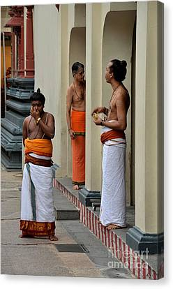 Hindu Priests Relax After Morning Rituals Singapore Canvas Print by Imran Ahmed