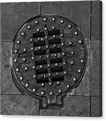 Hinged Manhole Cover Canvas Print by Lynn Palmer