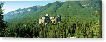 Evergreen Trees Canvas Print - Historic Banff Springs Hotel In Banff by Panoramic Images