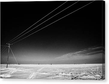 Hoar Frost Covered Electricity Transmission Lines Snow Covered Prairie Agricultural Farming Land Wit Canvas Print by Joe Fox