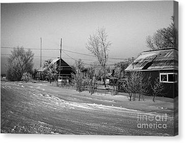 hoar frost covered street in small rural village of Forget Saskatchewan Canada Canvas Print by Joe Fox