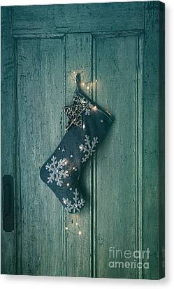 Entrance Door Canvas Print - Holiday Stocking With Lights Hanging On Old Door by Sandra Cunningham