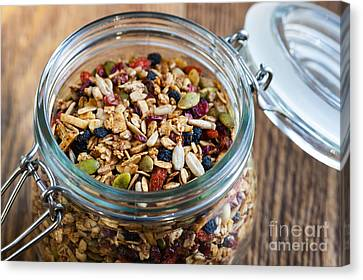 Homemade Granola In Open Jar Canvas Print by Elena Elisseeva