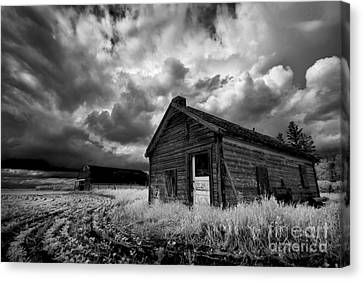 Homestead Under Stormy Sky Canvas Print