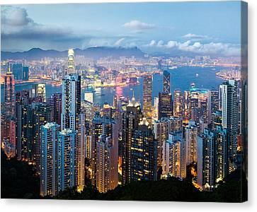 Hong Kong At Dusk Canvas Print by Dave Bowman