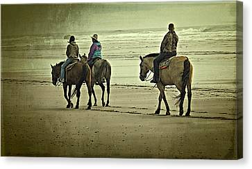Canvas Print featuring the photograph Horseback Riding On The Beach by Thom Zehrfeld