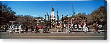 St.louis Cathedral Canvas Print - Horsedrawn Carriages On The Road by Panoramic Images