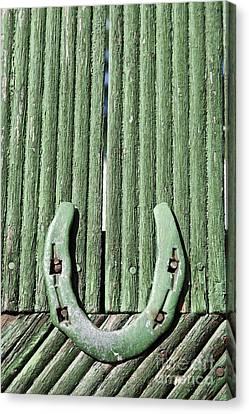 Horseshoe Nailed To A Green Door Canvas Print