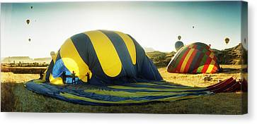 Eco-tourism Canvas Print - Hot Air Balloon Being Deflated by Panoramic Images