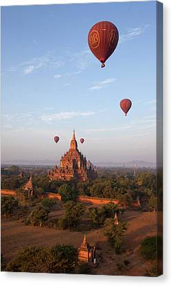 Hot Air Balloons And Pagodas Canvas Print by Peter Menzel