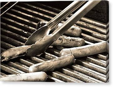 Hot Dogs On The Grill Canvas Print by Dan Sproul