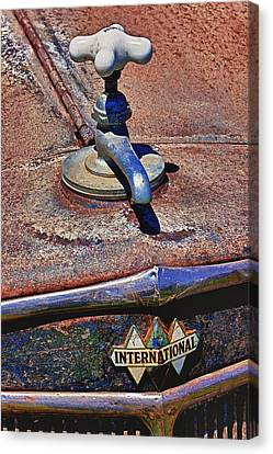 Hot Faucet Hood Ornament Canvas Print by Garry Gay