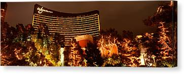 Hotel Lit Up At Night, Wynn Las Vegas Canvas Print by Panoramic Images