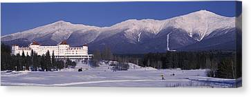Hotel Near Snow Covered Mountains, Mt Canvas Print by Panoramic Images