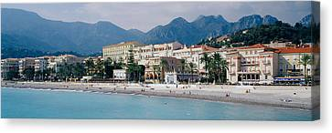 Hotels On The Beach, Menton, France Canvas Print by Panoramic Images