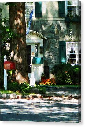 Dappled Canvas Print - House With Turquoise Shutters by Susan Savad