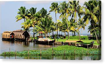 Exoticism Canvas Print - Houseboats Docked Along Shore by Steve Roxbury