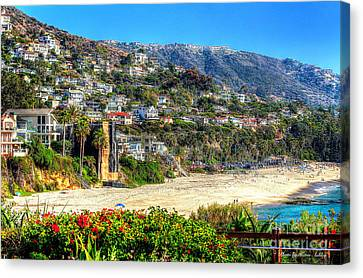 Houses By The Sea Canvas Print by Kevin Ashley