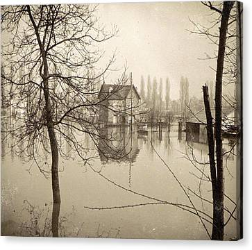 Houses In Flooded Suburb Of Paris Seen Through Bare Trees Canvas Print by Artokoloro