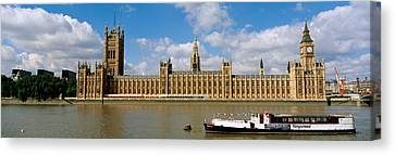 Houses Of Parliament, Water And Boat Canvas Print by Panoramic Images