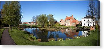 Houses Reflected In A Tranquil Pond Canvas Print by John Short