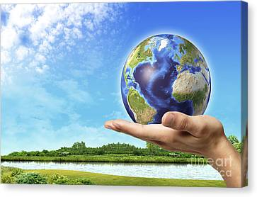 Human Hand Holding Earth Globe Canvas Print by Leonello Calvetti