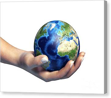 Human Hand Holding Planet Earth Canvas Print by Leonello Calvetti
