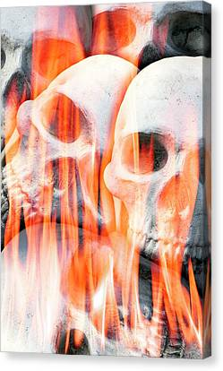 Human Skulls In Flames Canvas Print by Victor De Schwanberg