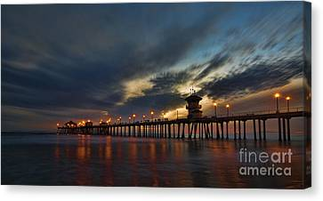 Huntington Beach At Night Canvas Print by Peter Dang