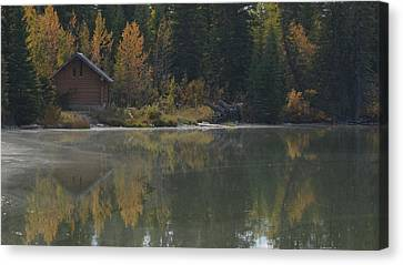 Hut By The Lake Canvas Print by Cheryl Miller