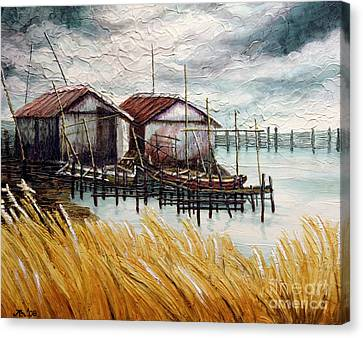 Huts By The Shore Canvas Print