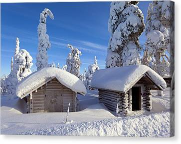 Huts In Forest After Heavy Snowfall Canvas Print by Science Photo Library