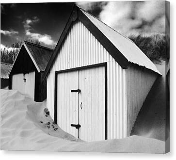 Huts In Sand Canvas Print