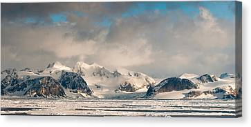 Ice Floes And Storm Clouds In The High Canvas Print